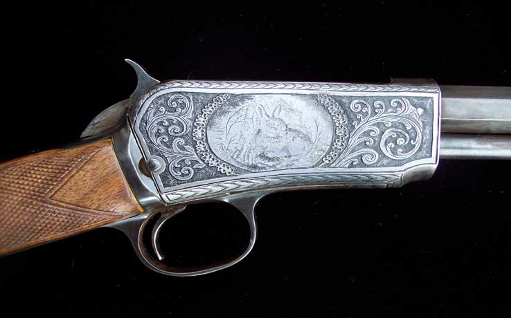Winchester 22 with engraved rabbit and scrolls