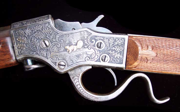 engraved gun with squirrel